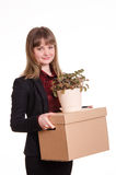 Portrait of a girl with big box and potted plant in hands Royalty Free Stock Photography
