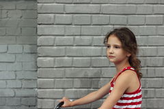 Portrait of a girl on a bike Stock Photo