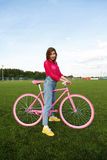 Portrait of girl with a bike outdoors Stock Photography