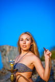 Portrait of the girl in bikini with hookah Royalty Free Stock Photography