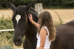 Young girl with her horse in a natural dressage exhibition in Lugo, Spain, june 2015 stock photography