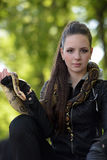 Portrait of a girl in a black leather jacket with python Stock Images