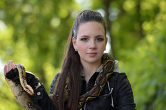 Portrait of a girl in a black leather jacket with python Stock Photography