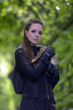 Portrait of a girl in a black leather jacket with python Royalty Free Stock Photos