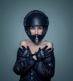 Portrait of a girl in a black motorcycle helmet and jacket Stock Images