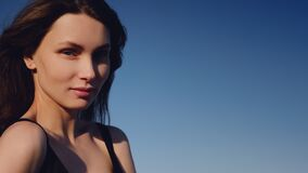 Portrait of a girl in a black swimsuit, close-up, fashion concept