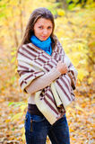 Girl with a blanket in autumn forest. Autumn portrait of a girl with a blanket Stock Photos