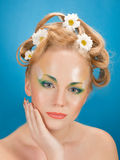 Portrait girl  blonde with flowers in her hair Royalty Free Stock Photo