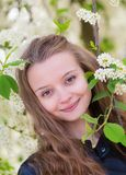 Portrait of a girl with blooming tree Stock Image