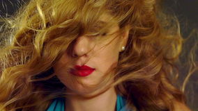 Portrait of girl with blowing hair in wind. Slow motion. stock video
