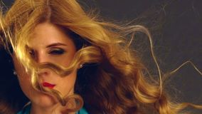 Portrait of girl with blowing hair in wind. Slow motion. stock video footage
