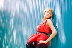 Blonde girl posing. Young girl posing on the blue background Royalty Free Stock Photos