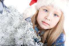 Portrait of a girl with blue eyes in a Christmas h. Cute Portrait of a girl with blue eyes in a Christmas hat Stock Photography