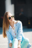 Portrait of a girl in a blue suit,sitting near the office Royalty Free Stock Image