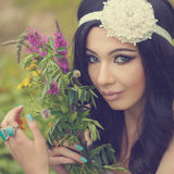 Portrait of Girl Boho with bouquet of wildflowers. Stock Image