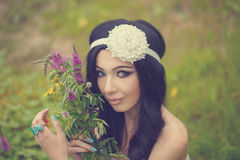 Portrait of Girl Boho with bouquet of wildflowers. Stock Photos