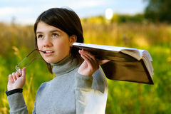 Portrait of girl with book Royalty Free Stock Image