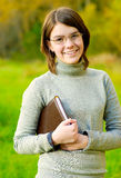 Portrait of girl with book Royalty Free Stock Photo