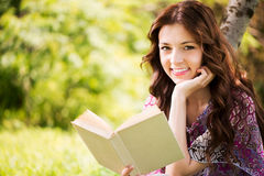 Portrait of Girl with a book in the park Stock Photo
