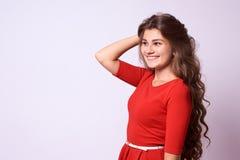 Portrait girl. Bordered brunette. Sincere smile. White background. Brown girl Stock Image