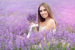 Portrait of girl with bouquet at lavender field Royalty Free Stock Image