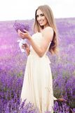 Portrait of girl with bouquet at lavender field Stock Photo