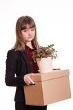 Portrait of a girl with box fired and flower in hands. Sad girl fired from her job and holding a box with things Stock Photography