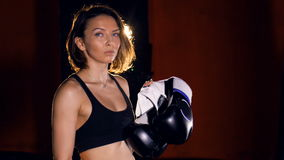 The portrait of the girl boxer with boxing gloves. 4K. stock video footage