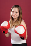 Portrait of girl in boxing gloves Stock Photos