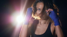 The portrait of the girl boxing in slowmotion. HD. The portrait of the girl boxing in slowmotion stock video footage