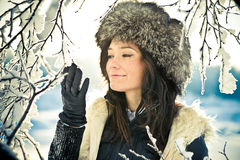 Portrait of a girl with a branch in a fur hat Stock Photos