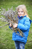 Portrait Girl with a branch of pussy willow. Salix. Easter traditions. Royalty Free Stock Photography