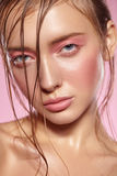 Portrait of girl with bright pink make-up. Royalty Free Stock Photography