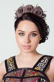 Portrait of a girl brunete with hair beam with a delicate make up and a wreath in her hair from black roses with thorns rock Stock Images