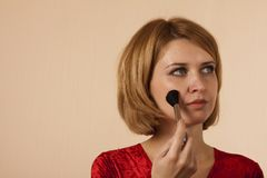 Portrait of the girl with a brush for make-up Stock Photo