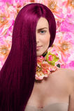 Portrait of a girl with burgundy hair on floral background Royalty Free Stock Photos