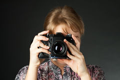 Portrait of a girl with a camera Stock Photography