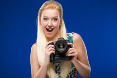 Portrait of a girl with a camera in hands Royalty Free Stock Photography