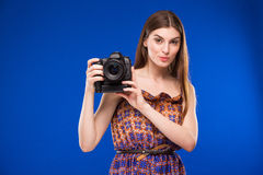 Portrait of a girl with a camera in hands Royalty Free Stock Photos