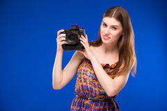 Portrait of a girl with a camera in hands Stock Photography