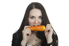 Portrait of a girl with a carrot Stock Photos