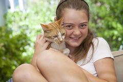 Portrait of girl with cat. Outside in the garden Stock Photos