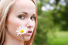 Portrait of a girl with chamomile. Closeup portrait of pretty girl with a chamomile Stock Photos