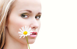 Portrait of a girl with chamomile. Closeup portrait of pretty girl with a chamomile, Isolated on a beige background Stock Photography
