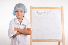 Portrait of a Girl chemist at the blackboard Royalty Free Stock Photography