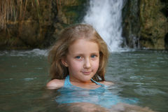 Portrait of a girl child bathing. Near waterfall Stock Image