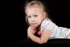 Portrait of a girl child on a black background. Cute portrait of a girl child on a black background Royalty Free Stock Images