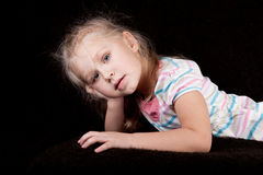 Portrait of a girl child leaning his head on his h Royalty Free Stock Image