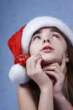 A portrait of girl is in the Christmas cap. Stock Image