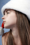 A portrait of girl is in the Christmas cap. Royalty Free Stock Photography